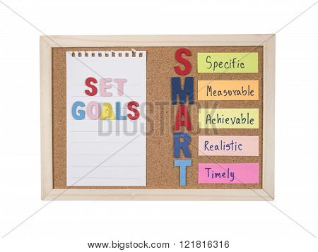 SMART Goals with cork board on isolated / white background (Business Concept)