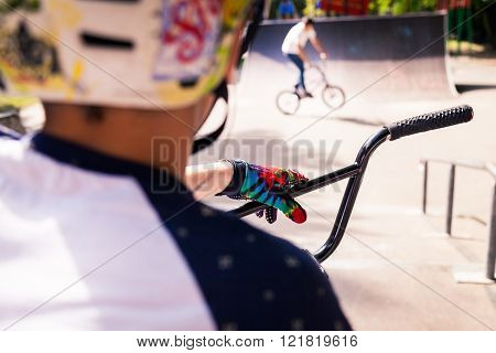BMX rider on his bicycle in a helmet