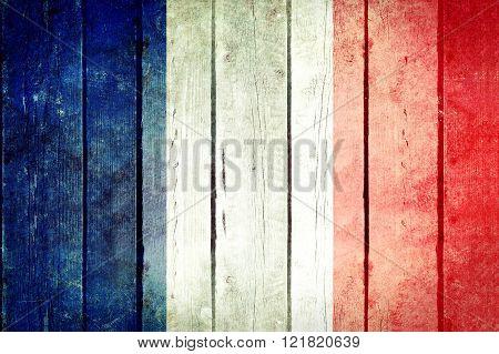France wooden grunge flag.