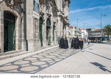 Students Walking In Front Of Carmelites Church. Porto.