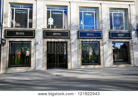 VILNIUS LITHUANIA - APRIL 12: Facade of Hugo Boss flagship store in Vilnius downtown on April 12 2015. Hugo Boss is a world famous retailer founded in Germany.