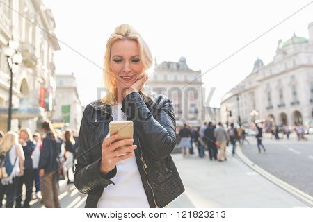 Adult Woman Looking At Smart Phone In London