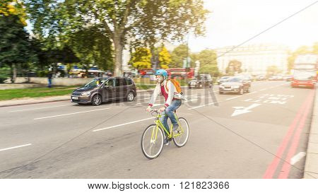 Hipster Man Cycling In London