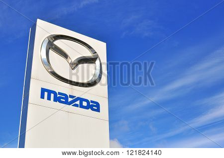 MOSCOW RUSSIA - OCTOBER 10 2015: Logotype of Mazda corporation on October 10 2015. Mazda is the Japanese automotive manufacturer.