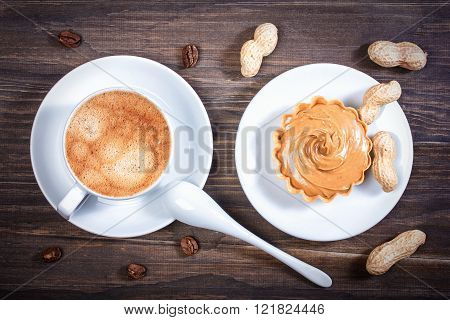 Espresso Coffee In A Ceramic Bowl, Basket Waffle With Peanut Butter, Peanuts, Coffee Beans On A Wood