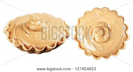Peanut Butter In A Waffle Basket, Isolate On A White Background, Closeup.