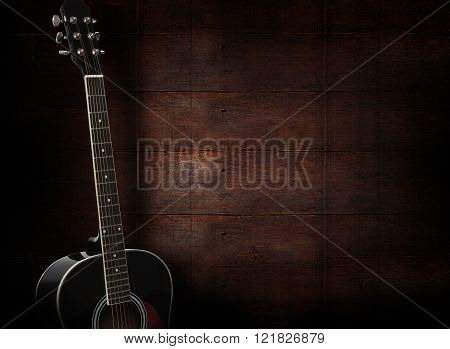 Black Acoustic Guitar On Dark Red Wooden Background.