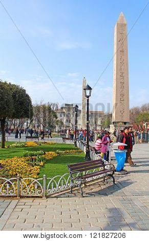 Tourists near Obelisk at hippodrome in Istanbul, Turkey