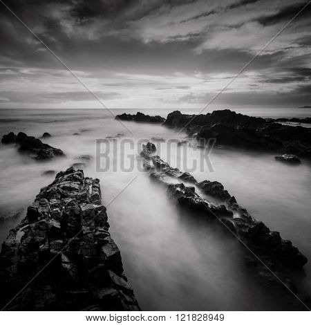 Long Exposure And Black And White Image Of Rocky Beach.slightly Noise And Soft Focus.nature Composit