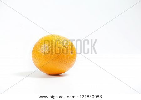 Orange Fruit In Section In White Water.