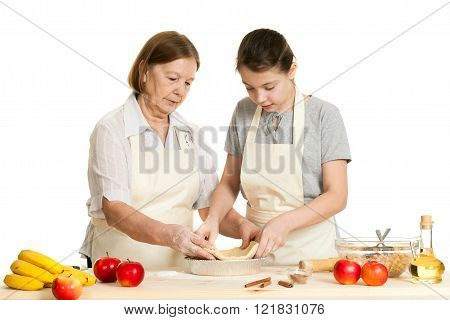 The Grandmother And The Granddaughter Stack Dough