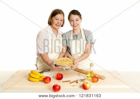 The Grandmother And The Granddaughter Hold Beautiful Pie