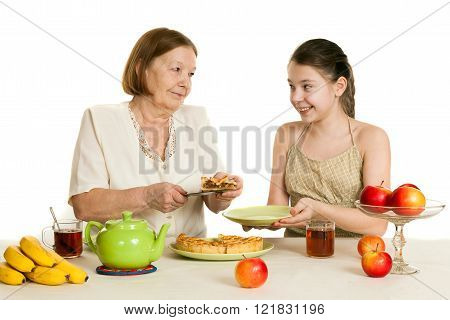 The Grandmother Treats The Granddaughter With Pie