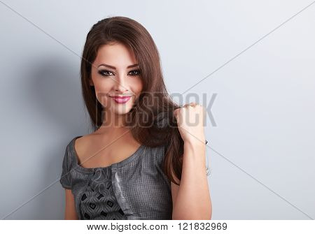 Sexy Makeup Female Brunette Model Holding Hair And Looking Confident