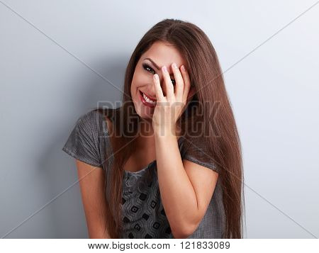 Happy Laughing Brunette Young Woman Cover The Hand Her Face And Giggling