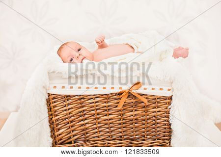 Little Baby (child) Lying In A Wooden Basket. Newborn