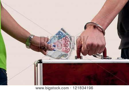 Business Transfer Deal. Handover Of A Suitcase For Money