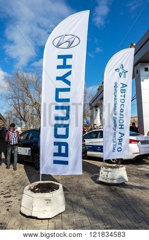 SAMARA RUSSIA - MARCH 13 2016: Dealership flags Hyundai and official dealer Argo company. Text in russian: