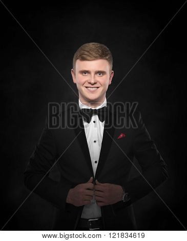 Young handsome man in black suit.