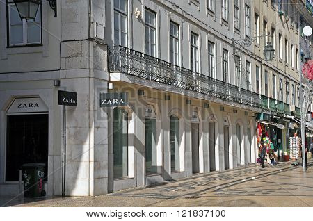 LISBON PORTUGAL - DECEMBER 19: Zara flagship store on Agusta street in Baixa district of Lisbon on December 19 2012. Lisbon is the largest city and capital of Portugal with a population of 547 000 citizens.