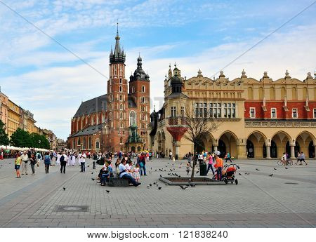 KRAKOW POLAND - JULY 20: Main Square of Krakow historical centre on July 20 2012. Krakow is one the most beautiful and visited cities of Poland.