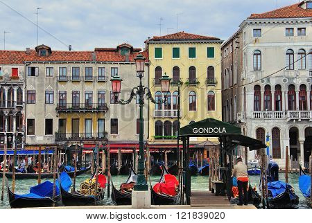 VENICE ITALY - SEPTEMBER 28: Gondolas station of Grand Canal in Venice downstation on September 28 2012. Venice is a city in northeastern Italy sited on a group of 118 small islands