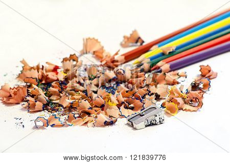 Colorful Pencils And Pencil Shavings On White Background
