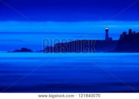 Beautiful moody blue colorful Lighthouse along pacific ocean coast in oregon