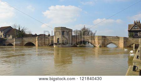 The Historic Parkhorse Bridge at St Ives Cambridgeshire with Chapel