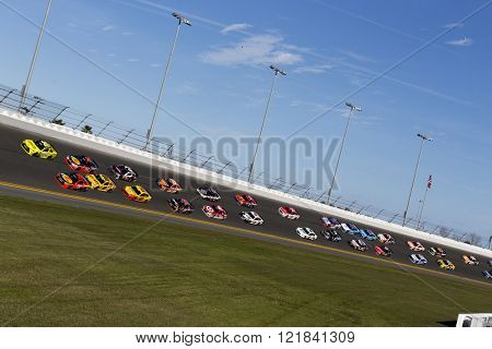 Daytona Beach, FL - Feb 21, 2016: The NASCAR Sprint Cup teams come off turn 4 during the Daytona 500 at the Daytona International Speedway in Daytona Beach, FL.
