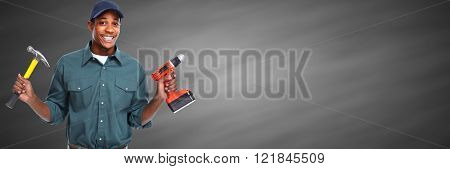 Worker man with hammer and drill.