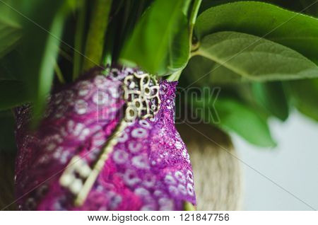 Antique Key On Lace Tape Green Leaves Flowers Abstract Background