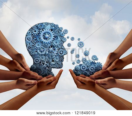 Group training and skill development business education concept with many diverse hands holding a bunch of gears transferring the wheels to a human head made of cogs as a symbol of acquiring the tools for team learning.