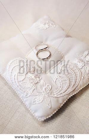 wedding rings on ring barer pillow