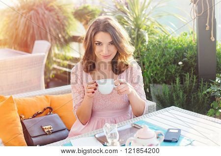 woman drinking coffee at the morning in a cafe
