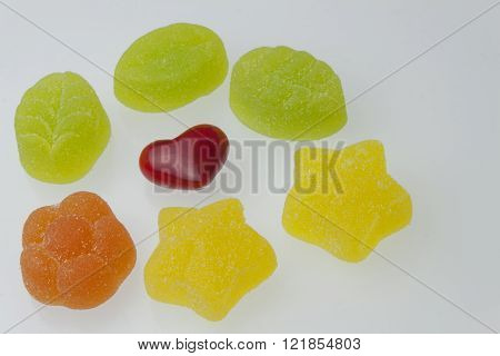 We love gummy candy. Heart and sweets for children. The dangers of obesity