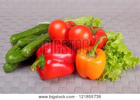 Cucumbers, Tomatoes, Paprika And Lettuce Leaves