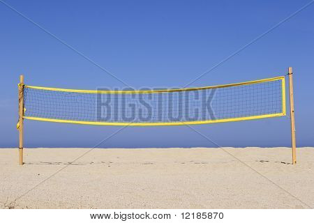 beach volleyball net on sandy beach, corsica, mediterranean