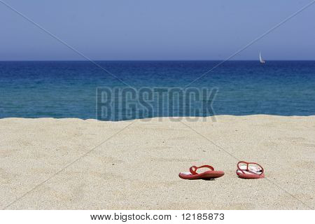 flip flops on empty sandy beach, corsica, mediterranean
