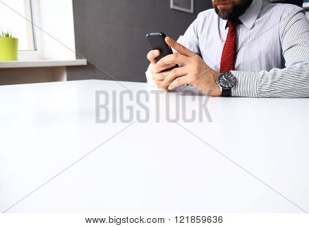 Close up of man using mobile smart phone