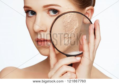 Concept Of Rejuvenation And Skin Care. Face Of A Beautiful Girl With Magnifier