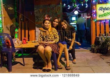 LAEM CHABANG, THAILAND, DECEMBER 26 : Thai women are sitting in front of a traditional Thai Karaoke wooden house in the city of Laem Chabang, Thailand.
