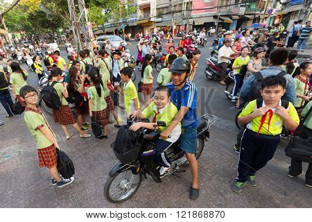 HO CHI MINH, VIETNAM, FEBRUARY 24 , 2015 : Vietnamese students in Chinese language are leaving school at the Ong Bon Pagoda, in Chinatown, district 5 of Ho Chi Minh Ville, (Saigon), Vietnam.