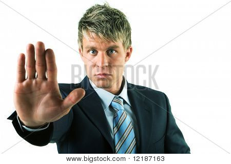 A man in a suit with an outstretched hand, stopping something, close-up, hand appearing big poster