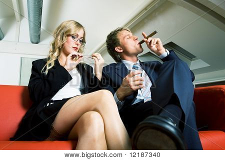 Boss smokes and drinks, secretary files her nails