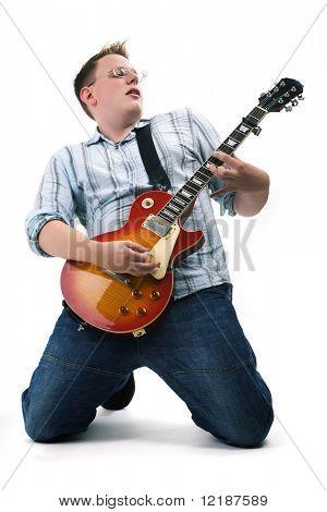 Guitarist kneeing playing his guitar