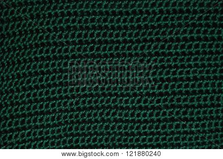 Crocheted rows of a green yarn. It gives an impression of chain mail, only softer.