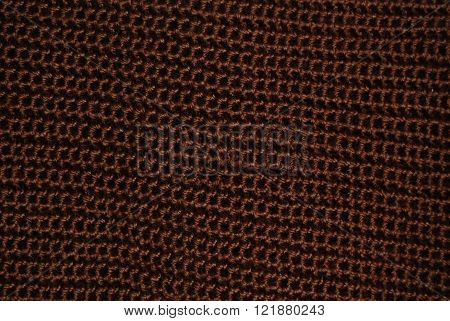 Crocheted rows of a brown yarn. It gives an impression of chain mail, only softer.
