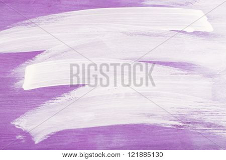 White strokes on violette wooden background.