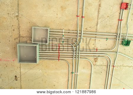 Electrical network installation on ceiling floor, Cable conduit.